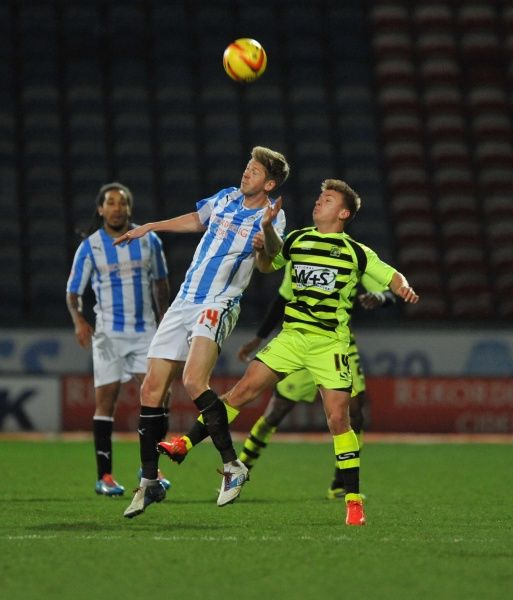 Huddersfield Town's Jonathan Stead wins high ball from Yeovil Town's Sam Hoskins - Photo mandatory by-line: Alex James/JMP - Tel: Mobile: 29/12/2013 - SPORT - FOOTBALL - John Smith's Stadium - Huddersfield - Huddersfield Town v Yeovil Town