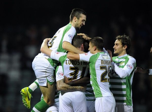 Yeovil Town's John Lundstram is mobbed by team mates after scoring - Photo mandatory by-line: Joe Meredith/JMP - Tel: Mobile: 03/12/2013 - SPORT - Football - Yeovil - Huish Park - Yeovil Town v Blackpool - Sky Bet Championship