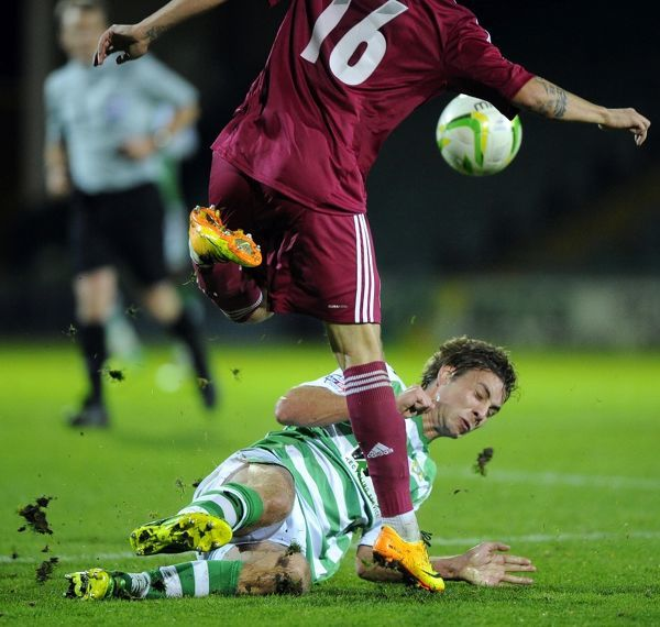 Yeovil Town's Sam Foley tackles Latvia Antons Kurakins - Photo mandatory by-line: Joe Meredith/JMP - Tel: Mobile: 18/11/2013 - SPORT - Football - Huish Park - Yeovil - Yeovil Town v Latvia - friendly