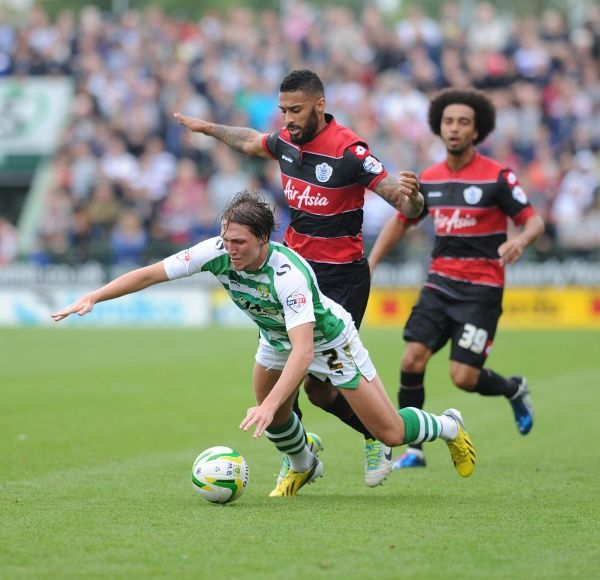 Yeovil Town's Luke Ayling gets fouled by Queen Park Rangers' Armand Traore - Photo mandatory by-line: Alex James/JMP - Tel: Mobile: 21/09/2013 - SPORT - FOOTBALL - Huish Park - Yeovil - Yeovil Town V Queens Park Rangers - Sky Bet Championship