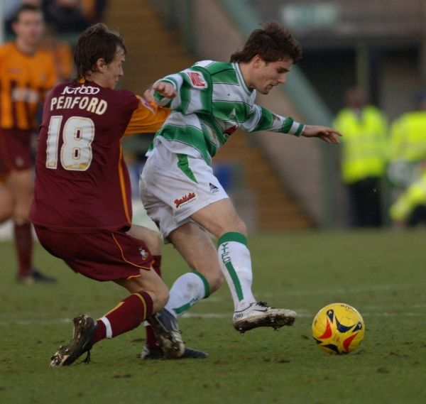 Yeovil's Arron Davies (R) tries to escape Bradford's Tom Penford during the Coca-Cola League One match at Huish Park, Yeovil, Saturday January 21, 2006
