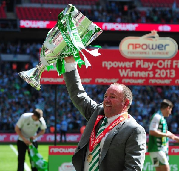Yeovil Town Manger, Gary Johnson picks up the cup after winning the League 1 Play Off final - Photo mandatory by-line: Dougie Allward/JMP - 19/05/2013 - SPORT - FOOTBALL - LEAGUE 1 - PLAY OFF - FINAL - Wembley Stadium - London - Brentford V